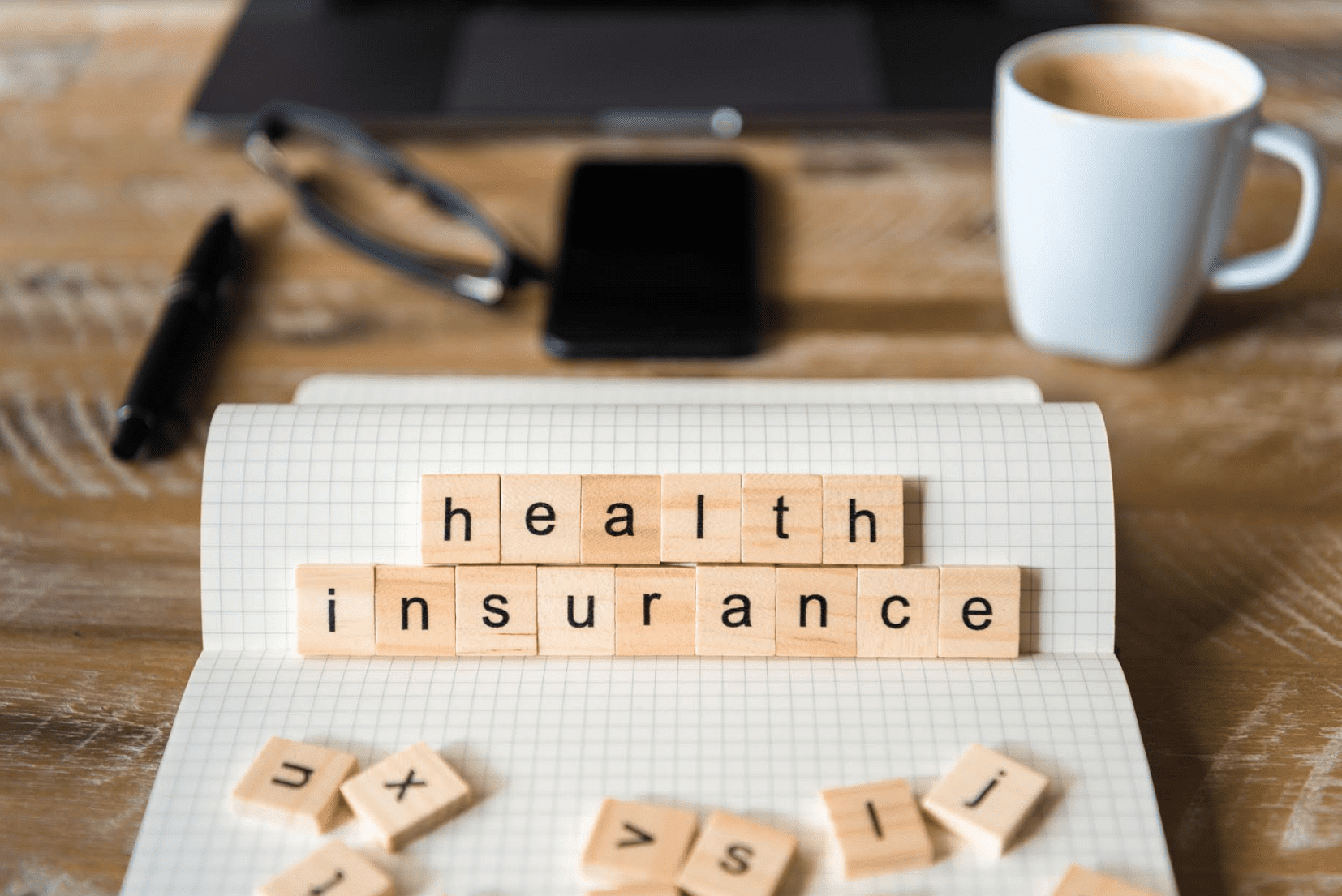 letters spelling out health insurance